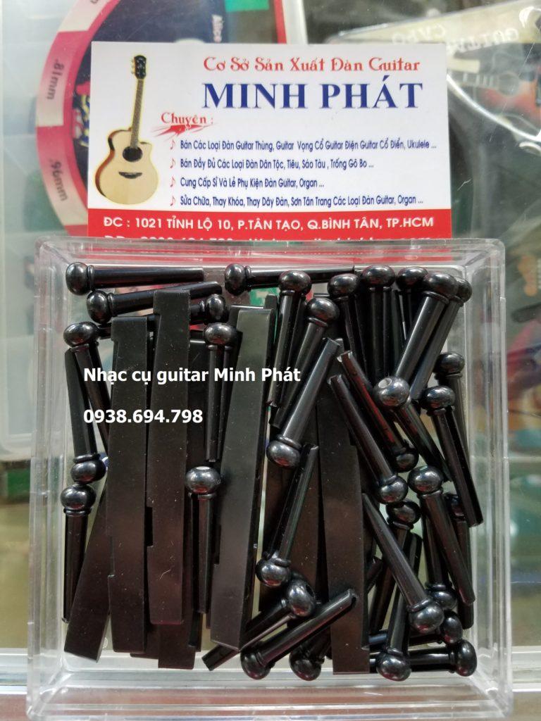 Chốt giữ dây đàn guitar