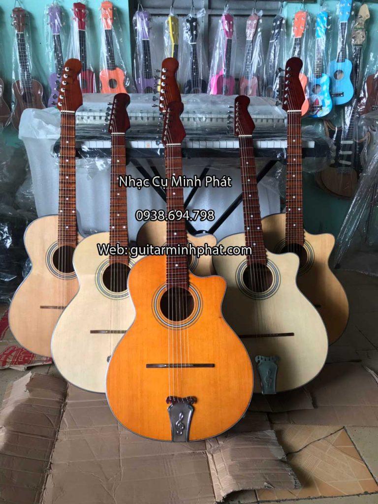 Hình ảnh chi tiết mặt trước gỗ thông của đàn guitar thùng phím lõm vọng cổ